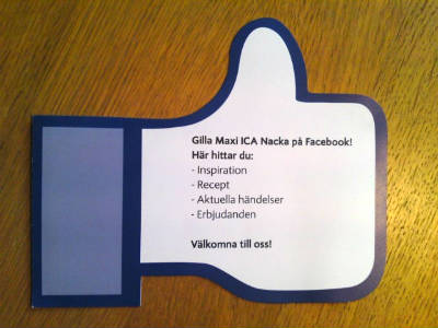 Postcard in the shape of a Facebook like thumbs up