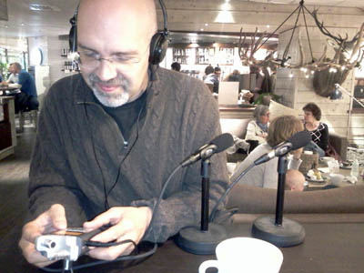 Picture of Jon Buscall and audio equipment in a cafe
