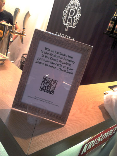 Krusovich sign at an event with QR code