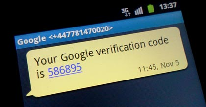 Photo of a mobile screen showing an SMS from Google containing a verification code