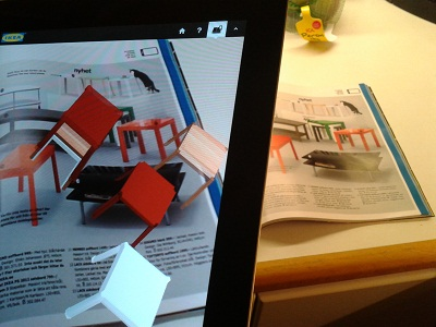 iPad showing a 3d animation with an IKEA catalogue in the background