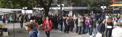 Long queue of people outside an electronics store in Stockholm